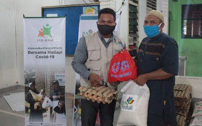 Paket Sembako CSR PLN Peduli Untuk Abang Beca